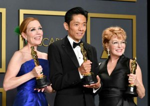 "Hairstylist Anne Morgan, special make-up effects artist Kazu Hiro, and makeup artist Vivian Baker, winners of the Makeup and Hairstyling award for ""Bombshell,"" pose in the press room during the 92nd Annual Academy Awards.[Getty/Kyodo]"